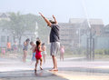 Child and grandpa playing at the whirlpool fountains Royalty Free Stock Photo