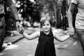 Child with grandparents in a park. Happy childhood. Black and white photo.