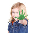 A child with green paint on her hand isolated on a white background Royalty Free Stock Images
