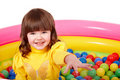 Child in group of colourful ball. Stock Photos