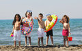 Child group have fun and play with beach toys Royalty Free Stock Photos