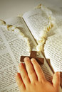 Child hand and cross on the Bible . Royalty Free Stock Photo