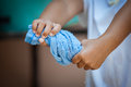 Child hands squeeze wet blue towel Royalty Free Stock Photo