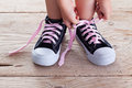 Child hands tie up shoe laces Royalty Free Stock Image