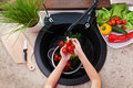 Child hands washing vegetables at the kitchen sink Royalty Free Stock Photo