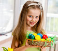 Child hang easter egg on cherry branch happy Stock Image