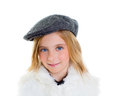 Child happy blond kid girl portrait winter cap smiling Royalty Free Stock Photography
