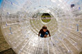 Child has a lot of fun in the zorbing ball Stock Photo
