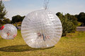 Child has a lot of fun in the zorbing ball Royalty Free Stock Photos