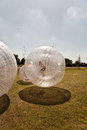 Child has a lot of fun in the zorbing ball Stock Images