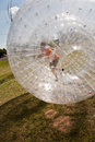 Child has a lot of fun in the zorbing ball Royalty Free Stock Photography