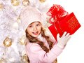 Child in hat and mittens holding red  gift box . Royalty Free Stock Photo