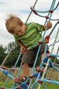 Child having fun on playground Royalty Free Stock Photo
