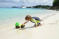 Child having fun on tropical beach near ocean toddler a white sand caribbean Stock Photography
