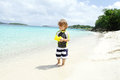 Child having fun on tropical beach near ocean toddler a white sand caribbean Royalty Free Stock Images