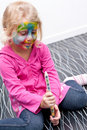 Child having her face painted Royalty Free Stock Image