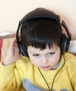 Child with headphones Stock Photo