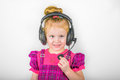 Child in the headphones microphone conversation sound music smile Royalty Free Stock Image