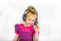 Child in the headphones microphone conversation sound music smile Stock Photos