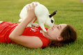 Child and her pet bunny playing outdoors a Stock Photo