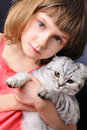 Child with her pet cat Royalty Free Stock Photos
