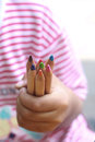 Child hold color pencils a with a little hand Stock Photography