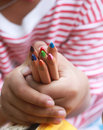 Child hold color pencils on little hand Royalty Free Stock Photo
