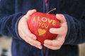 Child holding apple with i love you text Royalty Free Stock Photos