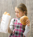 Child holding a bread little girl Royalty Free Stock Photo