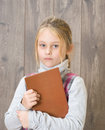 Child holding a brown book girl Stock Photography