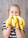 Child holding a bunch of bananas Royalty Free Stock Photo