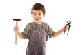 Child holding carpenter tools smiling studio shot Stock Images