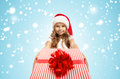 Child holding Christmas gift box in hand. Isolated Royalty Free Stock Photo