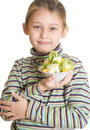 Child holding a dessert of ice cream and fruit isolated on white background Royalty Free Stock Photography