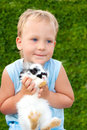 Child holding on hands of a small rabbit Royalty Free Stock Photos