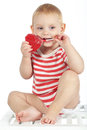 Child holding heart shaped candy Stock Photography