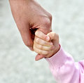 Child holding mother's hand Stock Photography