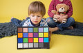 Child holding photography color checker card a for white balance Stock Image