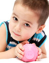 Child holding piggy bank little Royalty Free Stock Photo