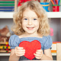 Child holding red paper heart Royalty Free Stock Images