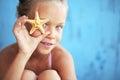 Child holding seashell on blue background Royalty Free Stock Photo