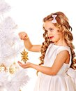 Child holding snowflake to decorate christmas tree isolated Stock Images