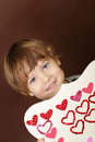 Child holding valentine s day craft with hearts heart stickers Royalty Free Stock Images
