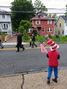 Child Holds an American Flag, Memorial Day Parade, USA Royalty Free Stock Photo
