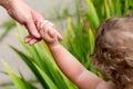 Child holds for finger moms Royalty Free Stock Photo
