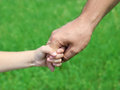 Child holds the hand of the father outdoor Stock Photography