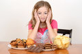 Child with huge pile of junk food Stock Image