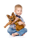 Child hugging a dog isolated on white background Royalty Free Stock Photo