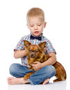 Child hugging a dog isolated on white background Stock Photo