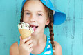 Child with ice cream portrait of years old kid girl eating tasty over blue Royalty Free Stock Photos